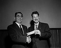 [Veterans of Foreign Wars (VFW) check presentation at Rudi restaurant, Los Angeles, California, December 7, 1954]
