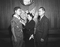 [Koyasan Boy Scout Troop 379 initiates Eagle Scouts at Court of Honor at Koyasan Buddhist Temple, Los Angeles, California, December 10, 1954]