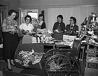 [Parent Teacher Association (PTA) Christmas gift wrapping, California, December 14, 1954]