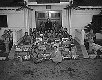 [Boy Scout Troop 379 collecting canned goods for Christmas Cheer drive, Los Angeles, California, December 20, 1954]