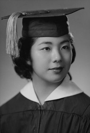 May Iwamoto in cap and gown, head and shoulder portrait ...