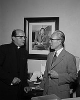 [Father Clement Boesflug and Mr. Tajita at Toyo Miyatake Studio, Los Angeles, California, August 25, 1955]
