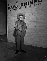 [Little boy movie star, George Matsui, from Shochiku in front of Rafu Shimpo, Los Angeles, January 1956]