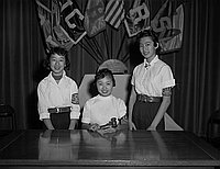 [Three Japanese American girls, student body officers at Virgil Junior High School, Los Angeles, California, February 17, 1956]