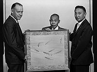 [Eijiro Suematsu and silk painting of trout for President Eisenhower, California, July 18, 1956]