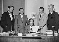 [Consul General of Japan discusses clothing donation to Japan with American Friends Service Committee, Los Angeles, California, November 7, 1956]