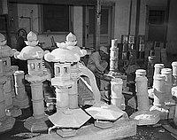 [Yoshio Ota and Japanese stone lanterns, Pasadena, California, December 7, 1956]