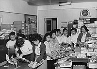 [Youths wrapping gifts for annual JACL Christmas Cheer program, Los Angeles, California, December 17, 1956]