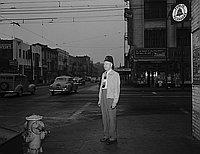 [Shriner William J. Gullett standing on street corner, Los Angeles, California, June 22, 1950]