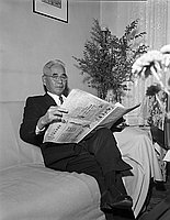 [Mr. Yoshino reading newspaper, 1956]
