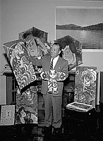 [Shigeru Nakamura, Consul General of Japan, holding Japanese kites, California, March 6, 1957]