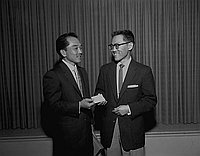 [Jockey George Taniguchi receives honorary Southwest Japanese American Citizens' League chapter membership at Centenary Methodist Church, Los Angeles, California, March 6, 1957]