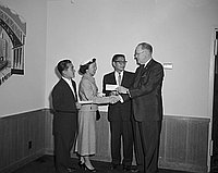 [Three Nisei seniors receiving Bank of America Achievement awards at Statler Hotel, Los Angeles, California, May 9, 1957]