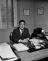 [Mr. Mitsumori sitting at desk, California, June 1957]