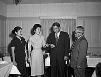 [Shonien receives a generous gift at Clifton's Cafe, Los Angeles, California, December 4, 1957]