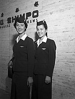 [Two airline stewardesses in front of Rafu Shimpo, Los Angeles, California, 1957]
