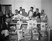 [Canned goods and rice donated to the JACL Christmas Cheer project, Los Angeles, California, December 1957]