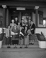 [ YWCA Magnolia Residence present $620 check to Centennial Victory Caravan, Los Angeles, California, February 28, 1955]
