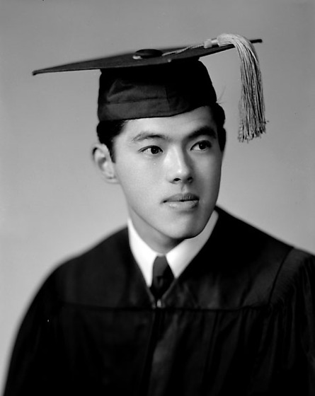 art kato in graduation cap and gown head and shoulder