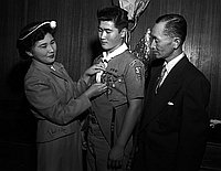 [Two boy scouts of Troop 379 receiving Eagle Scout rank, Los Angeles, California, July 8, 1955]