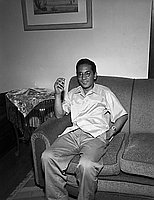 [Mr. Takeuchi, smoking on couch, California, July 21, 1955]