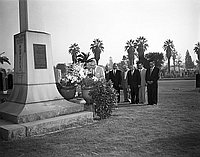 [Mr. Okusa of Japan visiting World War II Nisei memorial at Evergreen cemetery, Los Angeles, California, November 6, 1955]