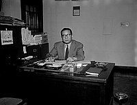[Toho Nakashima seated at desk, California, November 28, 1955]