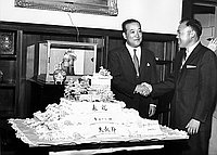 [George Izumi presents cake to Japanese Consul General Shigeru Nakamura for Tenchosetsu, the Emperor's birthday, Los Angeles, California, April 29, 1958]