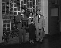 [Dorothy Yamada of Roosevelt High School receiving outstanding senior award from Japanese American Optimist Club, Los Angeles, California, January 28, 1958]