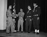 [Boys scouts of Troop 9 receiving Eagle Scout award at St. Mary's Episcopal Church, Los Angeles, California, June 13, 1958]