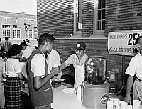 [PTA fathers work concession stand at Milk Bowl football game at Los Angeles High School, Los Angeles, California, October 17, 1958]