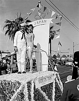 [Miss Japan with sailor on Miss Universe parade float, Long Beach, California, July 20, 1958]