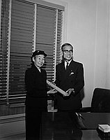 [Mrs. Tameji Eto receives Kunsho on behalf of her late husband at Japanese Consulate General's office, Los Angeles, California, January 8, 1959]