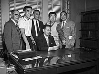 [Joint Nisei Trojan-Nisei Bruin donation to Japanese American Youth, Inc. at Kenji Ito's office, California, January 16, 1959]