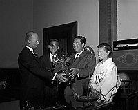 [Shuji Kawasaki, Japanese Diet member of Nagoya, presenting Japanese Samurai helmet to Los Angeles City at Mayor's office in City Hall, Los Angeles, California, August 26, 1959]