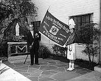[Fourth District Nisei Memorial Post 1961, Veterans of Foreign Wars, presenting banner to Maryknoll All Girls drum and bugle corps, Los Angeles, California, August 30, 1959]