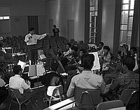 [Conductor Akira Kikukawa and Japanese American Orchestra rehearsal at St. Mary's Church, Los Angeles, California, April 1961]