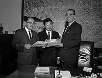 [Dave Yokoseki receiving flower seeds for Higashiyama Botanical Garden in Nagoya from Los Angeles Council man Karl L. Rundberg at Los Angeles City Hall, Los Angeles, California, October 23, 1961]