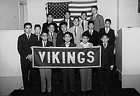 [Vikings Gra-Y Club receiving American flag flown over United States Capitol at Centenary Methodist Church, Los Angeles, California, February 6, 1962]