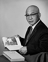 [Mitsuhiko Shimizu of Asahi Shoes and Dry Goods holding book, half-portrait, California, June 2, 1962]