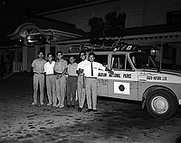 [Young men and automobile in front of Koyasan Buddhist Temple, Los Angeles, California, October 13, 1962]