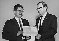 [Paul Saito receiving realtor membership of the Los Angeles Realty Board and California Real Estate Association at Toyo Miyatake Studio, Los Angeles, California, February 12, 1963]