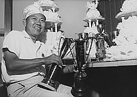 [George Izumi of Grace Pastries Shoppe with trophies, Los Angeles, California, October 30, 1963]