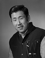 [Danny Hirata in letterman jacket, head and shoulder portrait, Los Angeles, California, December 14, 1963]