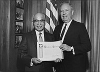 [Citation presentation to Mitsuhiko Shimizu of Asahi Shoes and Dry Goods by Supervisor Ernest Debs in his office, Los Angeles, California, February 26, 1964]