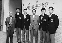 [Mikio Oda with track and field athletes from Japan in front of Rafu Shimpo office, Los Angeles, California, March 16, 1964]