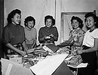 [Girl's Club wrapping toys for Christmas Cheer Project at Crossroads office, December 12, 1950]