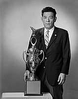 [Kaname Kuniyuki with Nozawa Boeki Judo trophy, California, April 10, 1965]