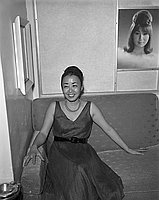 [Yurijo Amemiya on couch at Toyo Miyatake Studio, Los Angeles, California, April 1965]