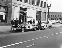 [U.S. - Japan Goodwill Sister City Mission automobiles in front of Rafu Shimpo, Los Angeles, California, January 1, 1966]